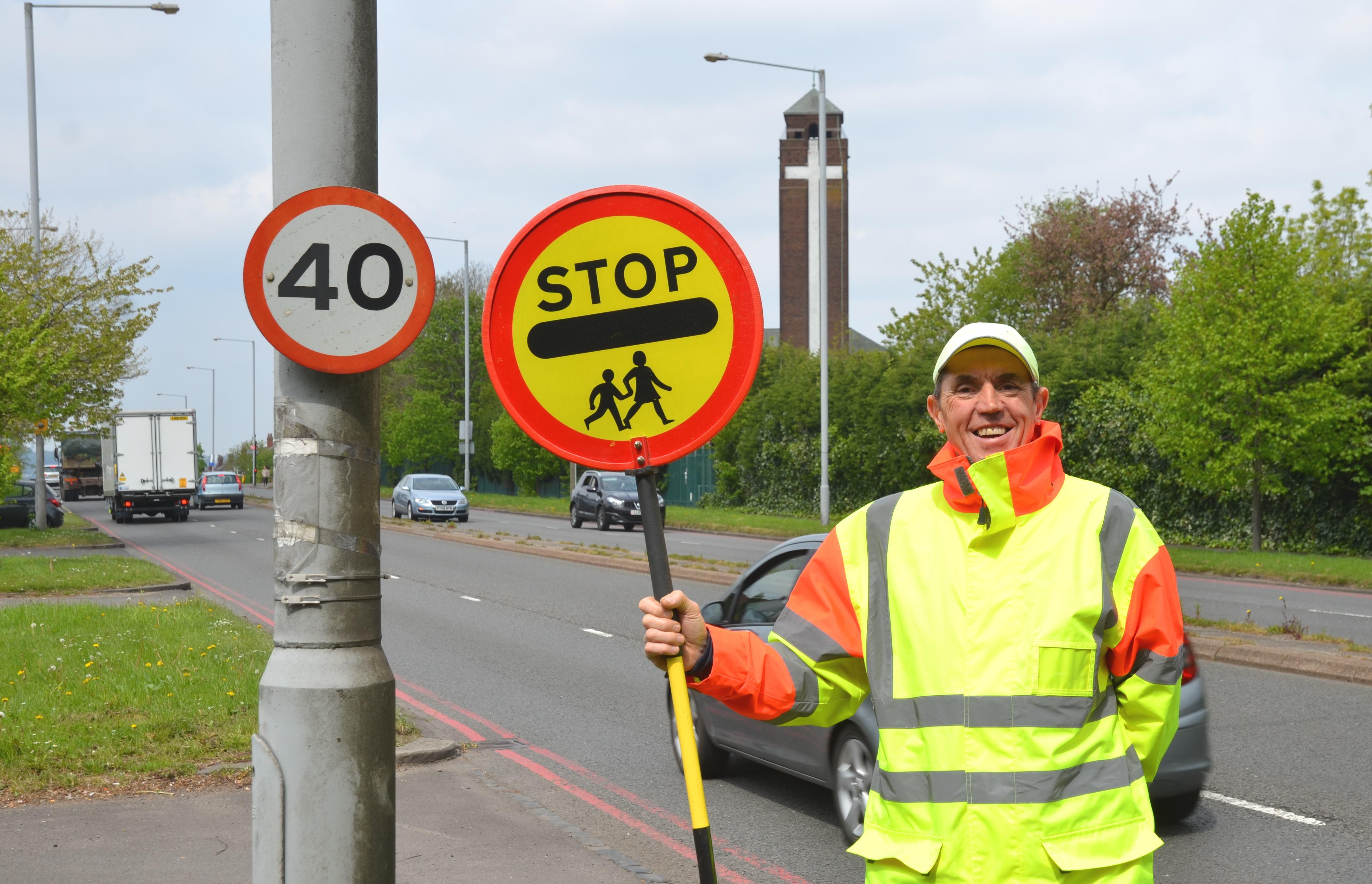 Lollipop man safeguarding the community Image